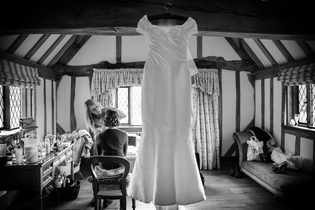 Wedding dress hanging on the beam.