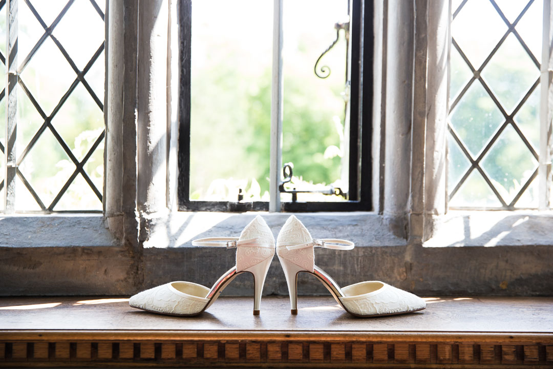 Wedding shoes on a old window ledge.