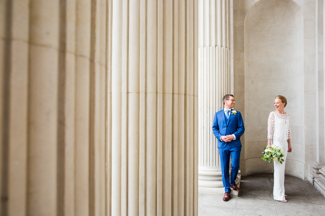 Bride and groom portrait by pillars